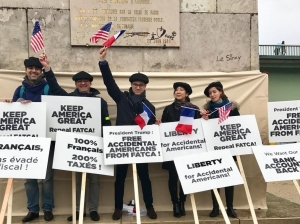 Above, some of the more than 150 Accidental Americans Association members who took part in a demonstration last November, during President Trump's visit to France