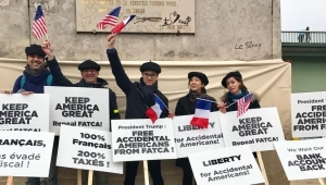 Some of the more than 150 members of the Association of Accidental Americans who demonstrate on the Île aux Cygnes in Paris in November, 2018, during President Trump's visit to the city